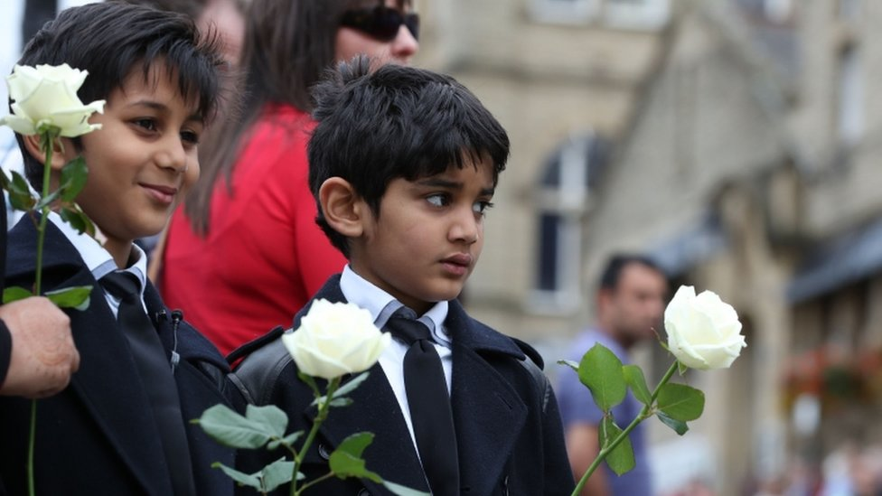 Boys holding white roses as Jo Cox funeral cortege approaches Batley