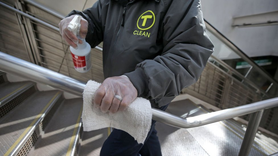 MBTA employees disinfect areas of the Government Center T Station in Boston on March 5, 2020, amid efforts to step up cleaning to defend against coronavirus