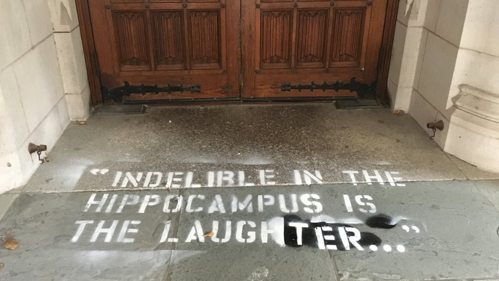 "Photo of graffiti on the floor that reads: ""Indelible in the hippocampus is the laughter"""