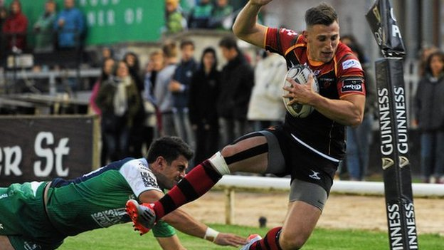 Dragons' Nick Scott is pushed into touch by Tiernan O'Halloran of Connacht