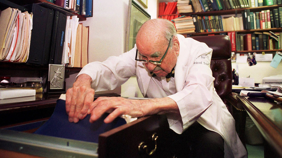 Dr. F. William Sunderman looks through some of the files in his office at the Pennsylvania Hospital in Philadelphia on June 11, 1999. Sunderman is a 100-year-old pathologist who was honored as America's official oldest living worker. Sunderman works at the Institute for Clinical Science at the Pennsylvania Hospital.