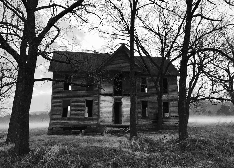 An empty house among trees
