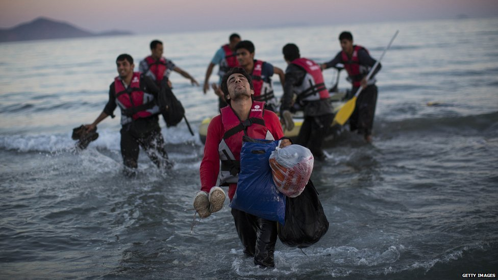 Migrants from Pakistan come ashore on the Greek island of Kos, 31 Aug 15