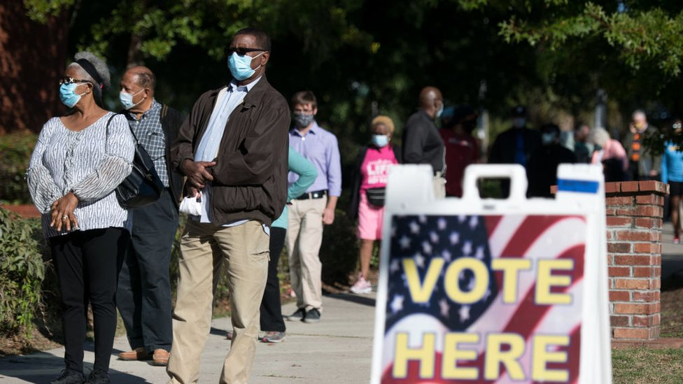People stand in line outside of an Elections Office on October 6, 2020 in Columbia, South Carolina