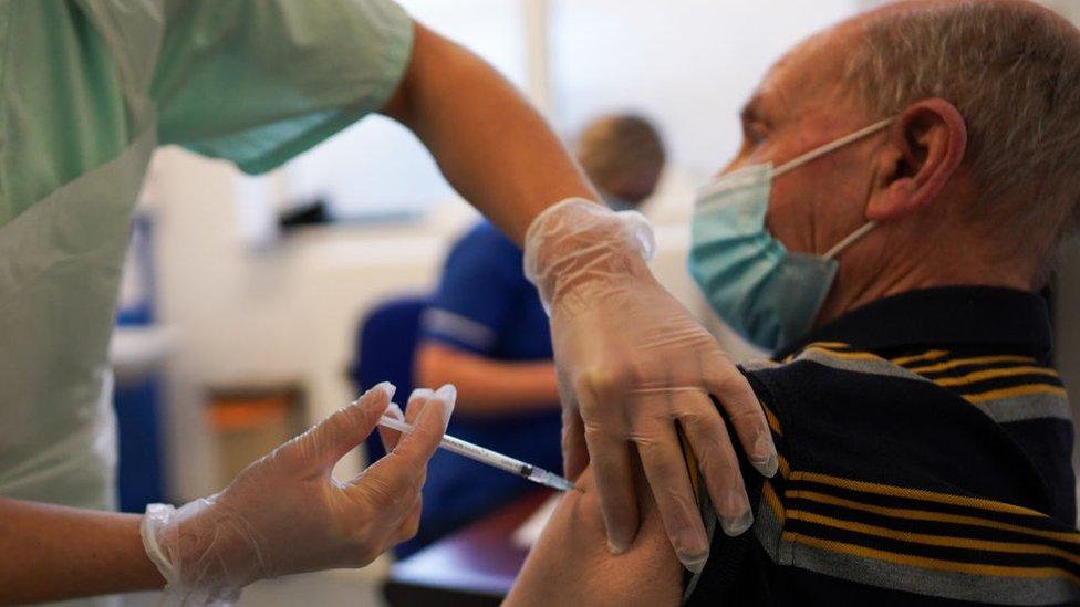 Man being vaccinated at a GP surgery
