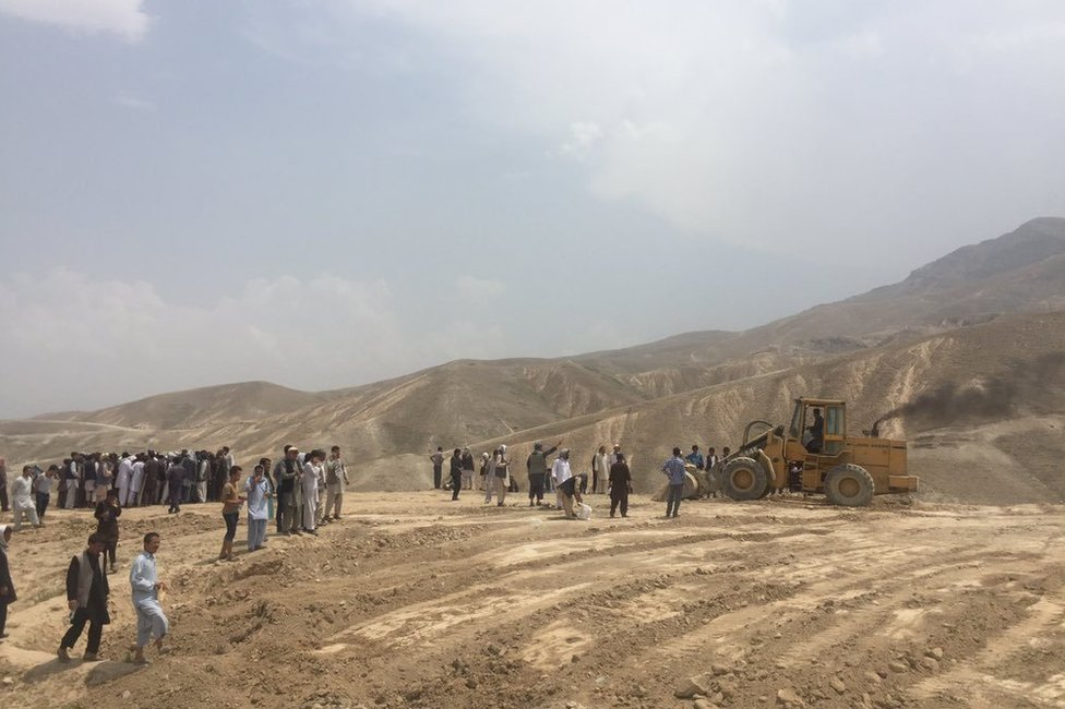 Preparation for digging graves on a hilltop in the west of Kabul, 24 July