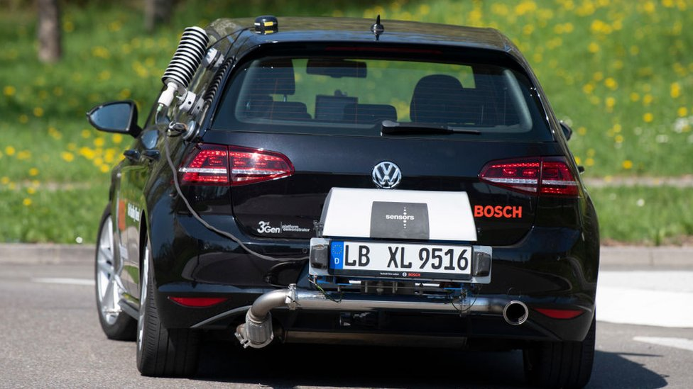 A diesel powered Volkswagen Golf testcar of German electronic and engineering company Bosch measures real drive emissions of NOx with a portable emission measurement system at its rear during a test drive in Stuttgart, southern Germany, on April 17, 2018.