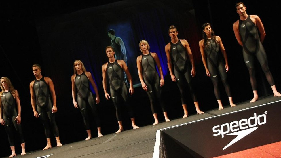 NZ swimmers posing with the specially designed swimsuits