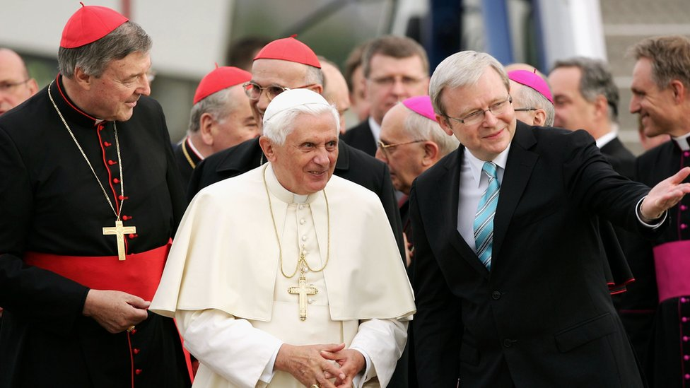 Pope Benedict XVI is welcomed on his arrival in Australia by Cardinal George Pell and Australian Prime Minister Kevin Rudd at the Richmond RAAF Air Base, on July 13, 2008
