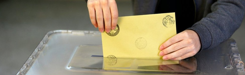 A man casts his ballot at a polling station during a referendum Aegean port city of Izmir,