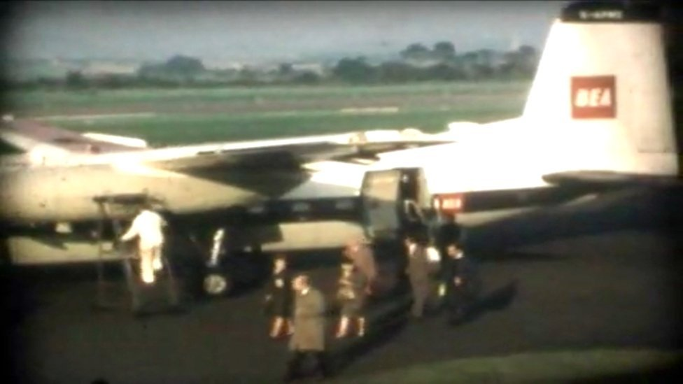 Passengers disembark a plane at Edinburgh Airport in 1965