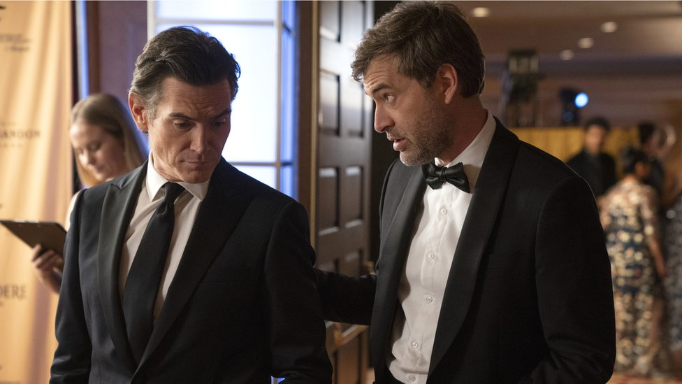 Billy Crudup plays Cory Ellison, the ratings-obsessed president of UBA's News Division, with Mark Duplass, who is Charles Black, The Morning Show's stressed executive producer