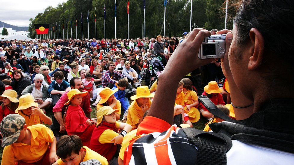 Hundreds gather outside parliament in Canberra in 2008 to watch a historic national apology to the Stolen Generations