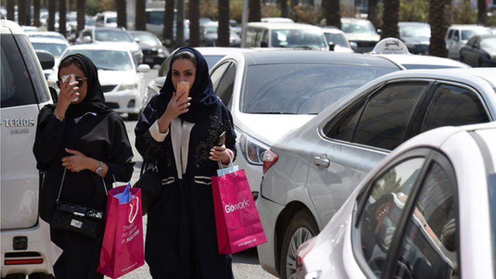 Women walk among traffic in Riyadh (file photo)
