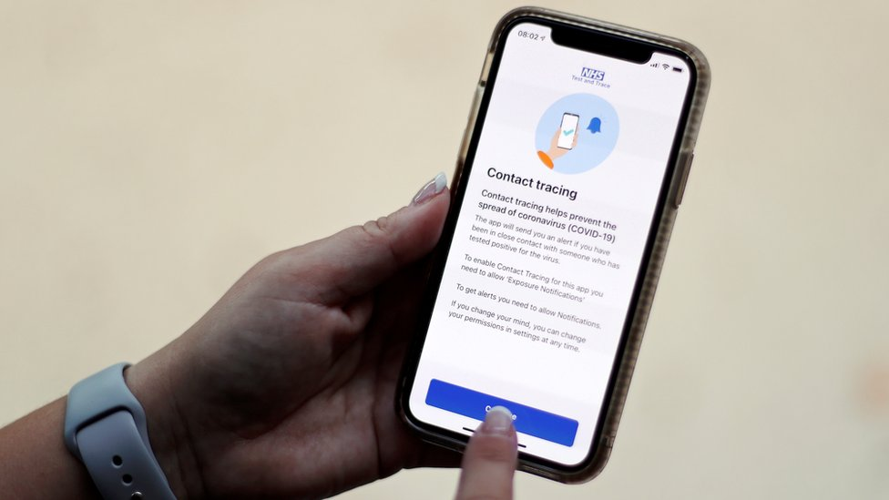 The coronavirus disease (COVID-19) contact tracing smartphone app of Britain's National Health Service (NHS) is displayed on an iPhone