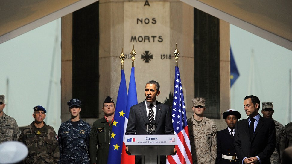 US President Barack Obama (L) talks next to his French counterpart Nicolas Sarkozy during a ceremony at a World War I memorial in Cannes on November 4, 2011 at the end of the G20 Summit for Heads of State and Government