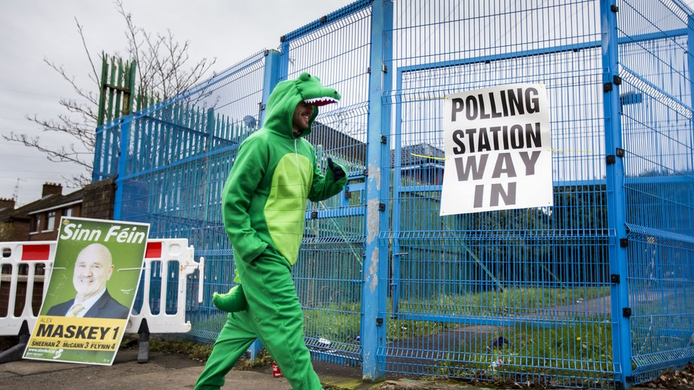 Irish language activist Dominic Sherry casts his vote at a West Belfast polling station