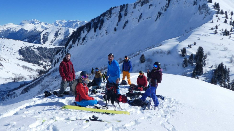 A group of friends, including Marc Sutton, on a mountain in France