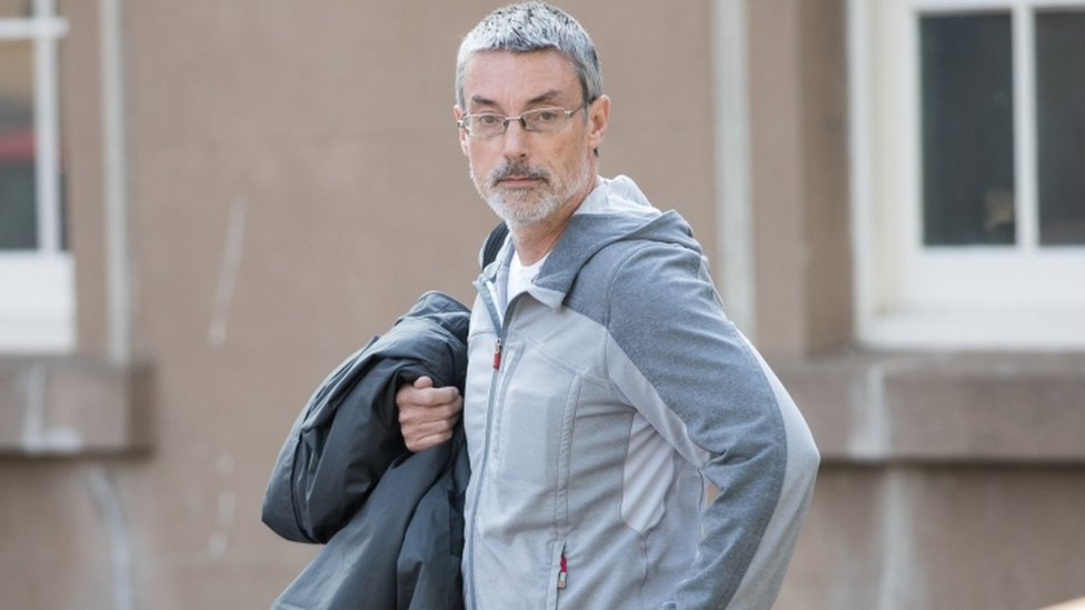 Simon Hayes arriving at Worcester Crown Court charged with perverting the course of justice by claiming not to know the identity of American pensioner Earl Roger Curry.