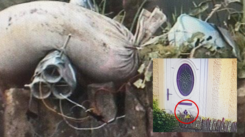 Police photos show the bomb just metres from the door of a house