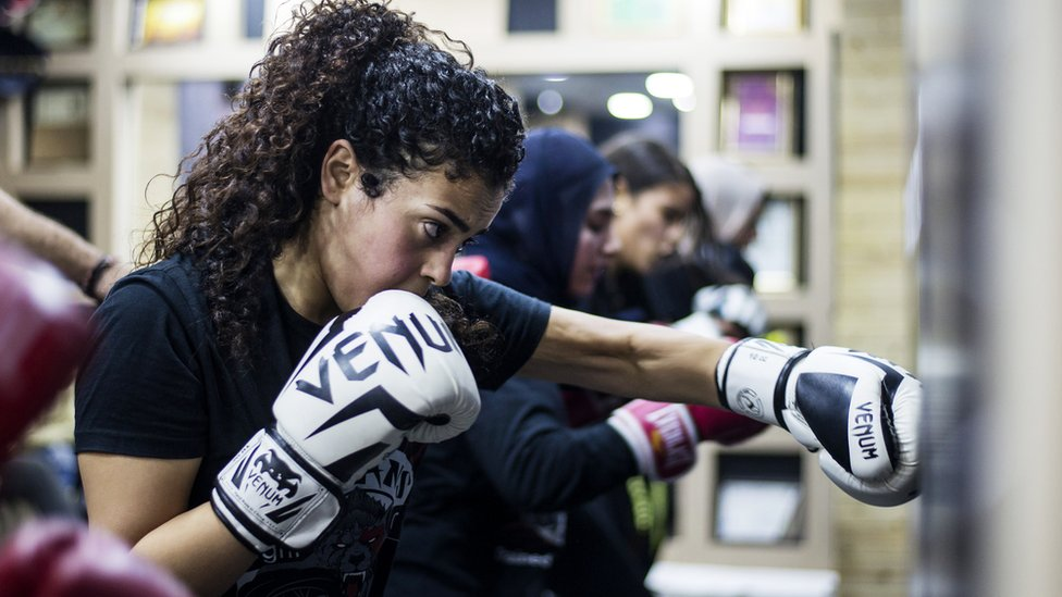 A woman boxing during a mixed martial arts class in Giza, Egypt - Sunday 24 November 2019