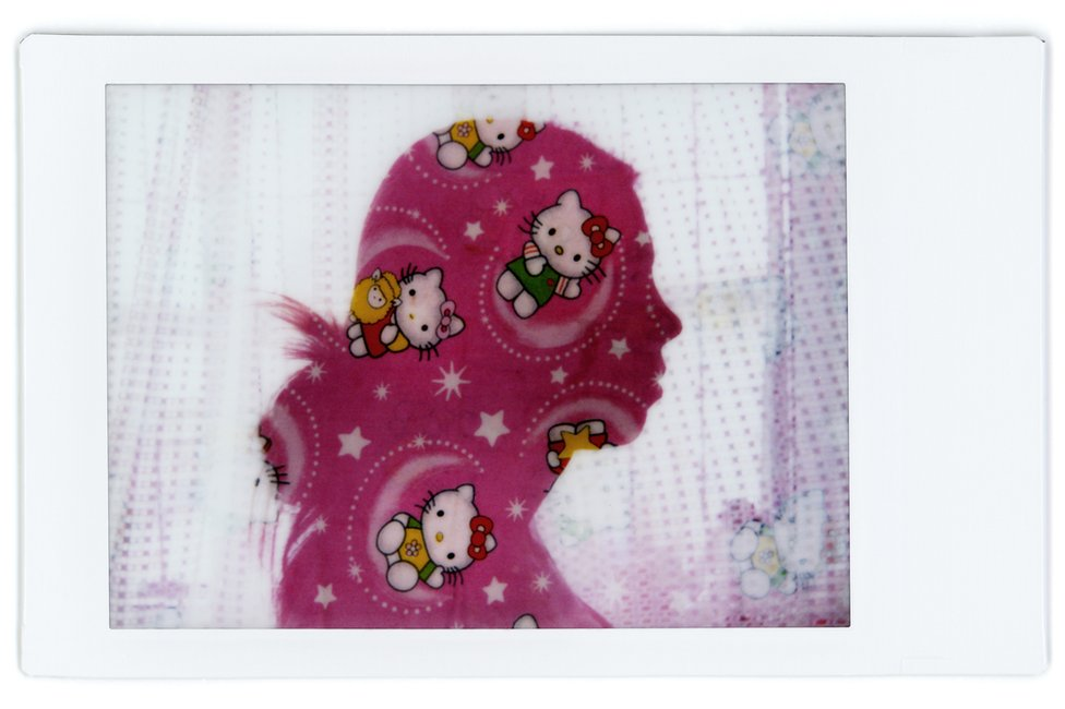 A composite image showing the profile of Elena with a patterned baby blanket over the top