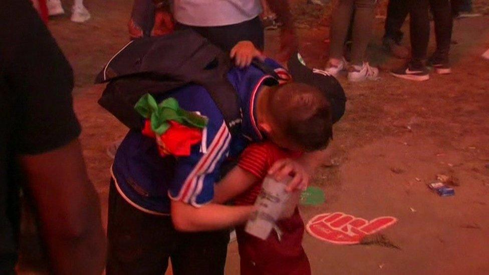 Portuguese boy hugs French fan