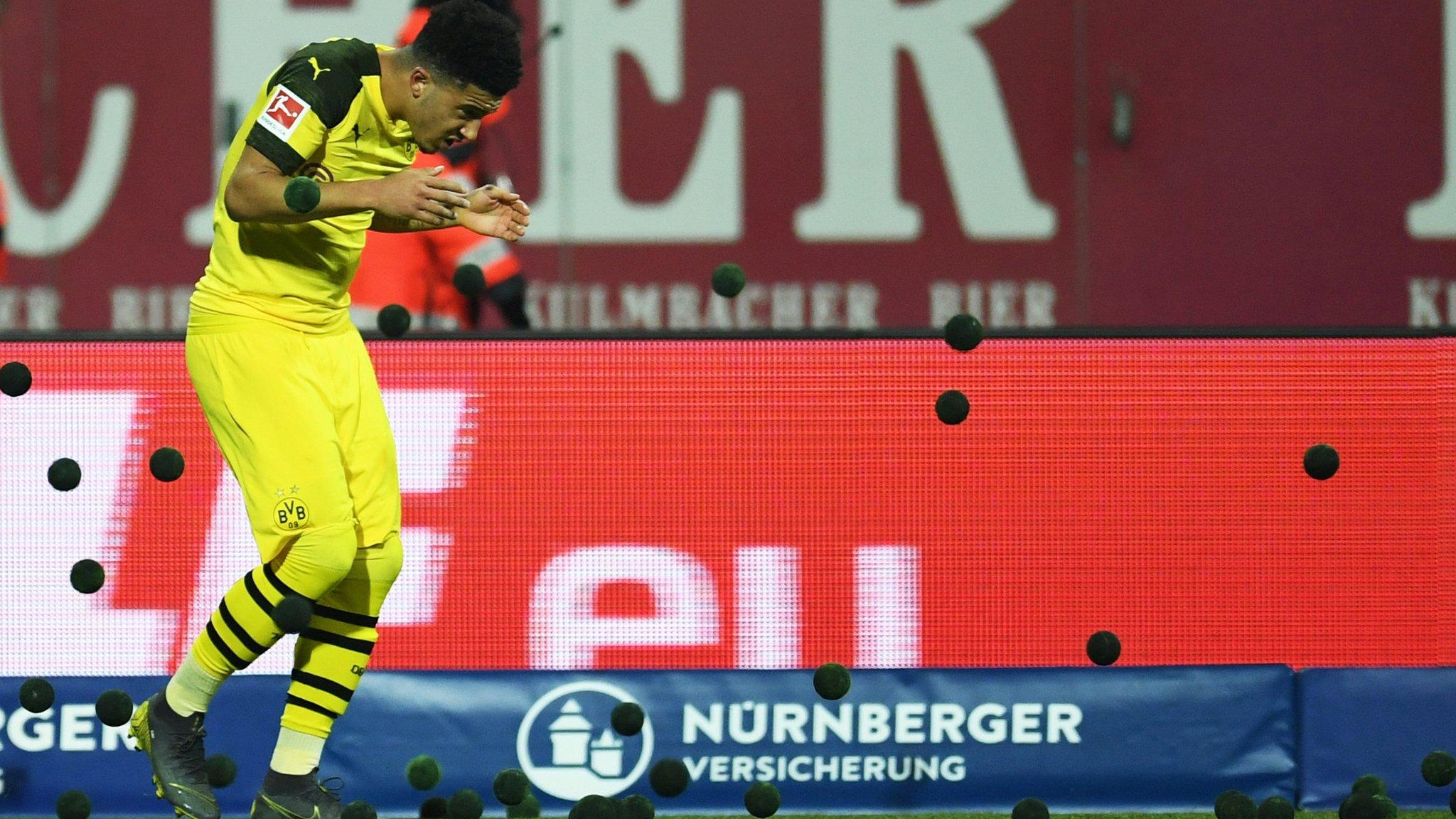 Nuremberg 0-0 Borussia Dortmund: Fans halt match by throwing tennis balls on pitch