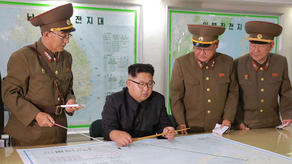 This picture taken on August 14, 2017 and released from North Korea's official Korean Central News Agency (KCNA) on August 15, 2017 shows North Korean leader Kim Jong-Un (C) inspecting the Command of the Strategic Force of the Korean People's Army (KPA) at an undisclosed location.