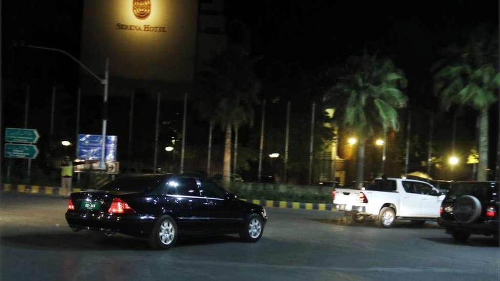 A car is photographed arriving at a hotel in Islamabad