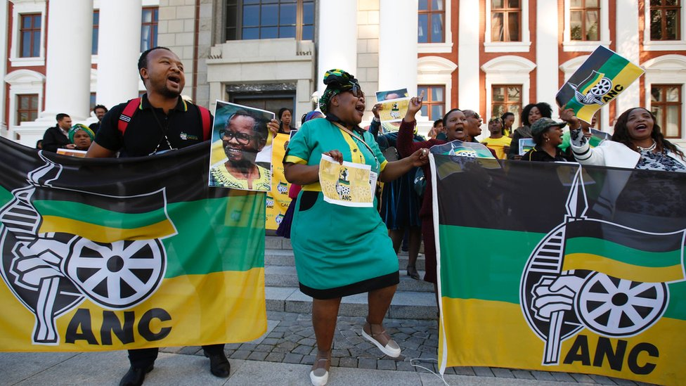 ANC supporters dance to celebrate President Zuma's victory