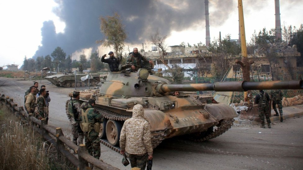 Syrian government forces patrol near Aleppo's power plant after taking control of the area on the eastern outskirts of the city from Islamic State (IS) group on 21 February 2016