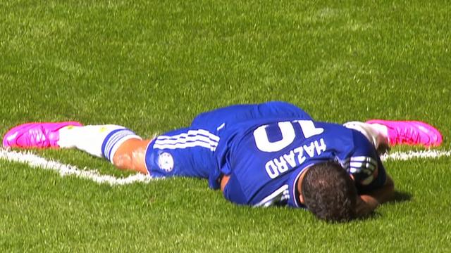 Chelsea's Eden Hazard reacts to his miss