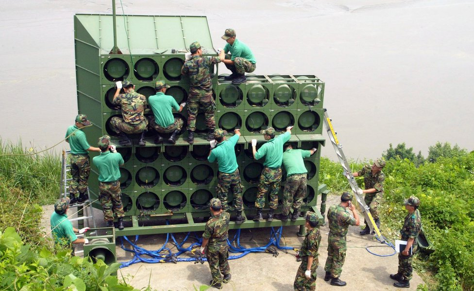 Army engineers assemble a huge speaker stack