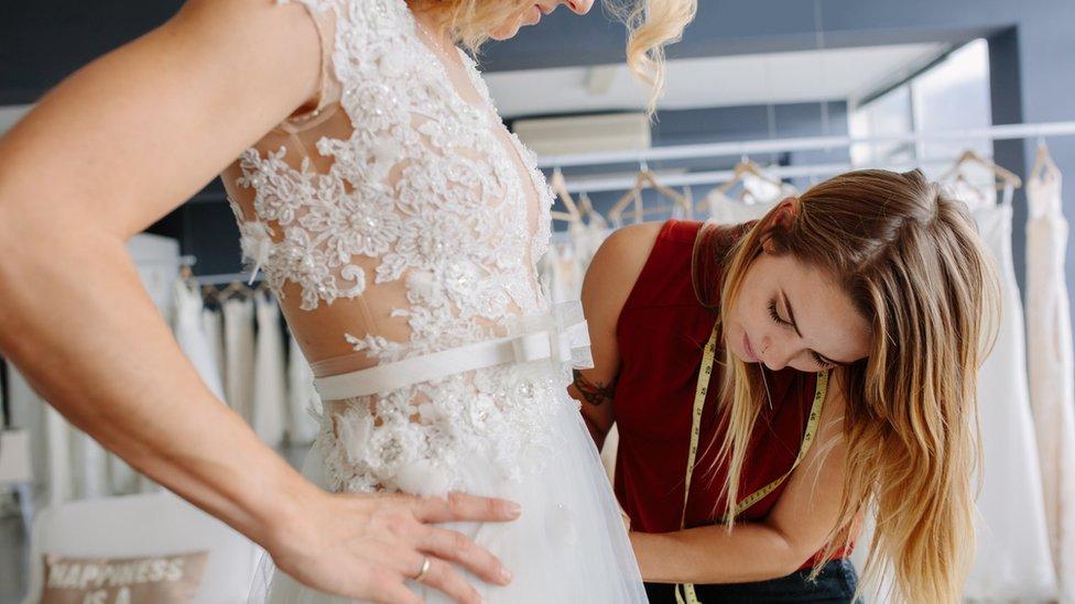A wedding dress fitting