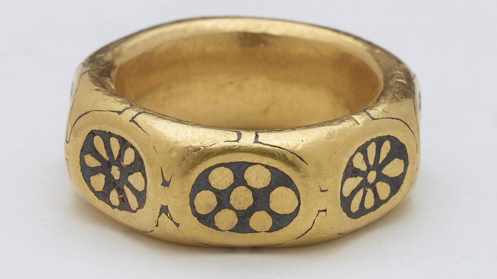 Close-up view of the gold finger ring