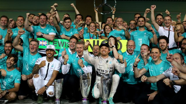 Lewis Hamilton and Nico Rosberg celebrate with the Mercedes team