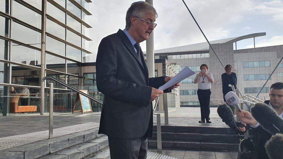 Mark Drakeford speaking on the Senedd steps