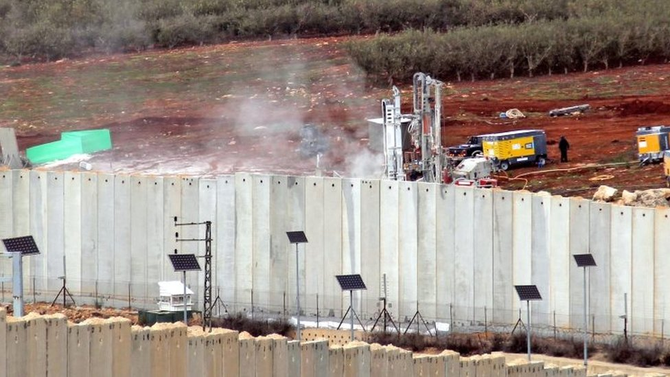 A view of Israeli machinery operating behind the border wall in Israel on 4 December