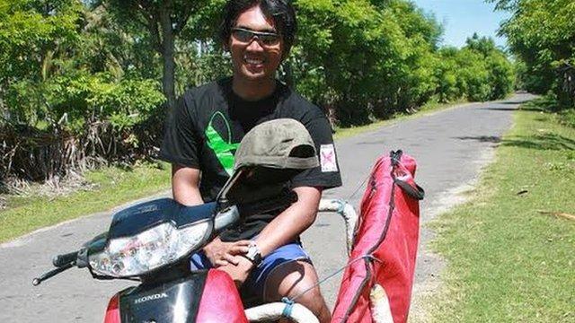 Aldi Haryopratomo on his motorbike