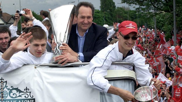 Gerard Houllier celebrates Liverpool's cup treble in 2001 on an open-top bus parade with Steven Gerrard and Sami Hyypia