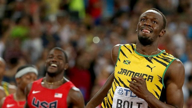 Jamaica's Usain Bolt wins 100m world title ahead of Justin Gatlin of the USA