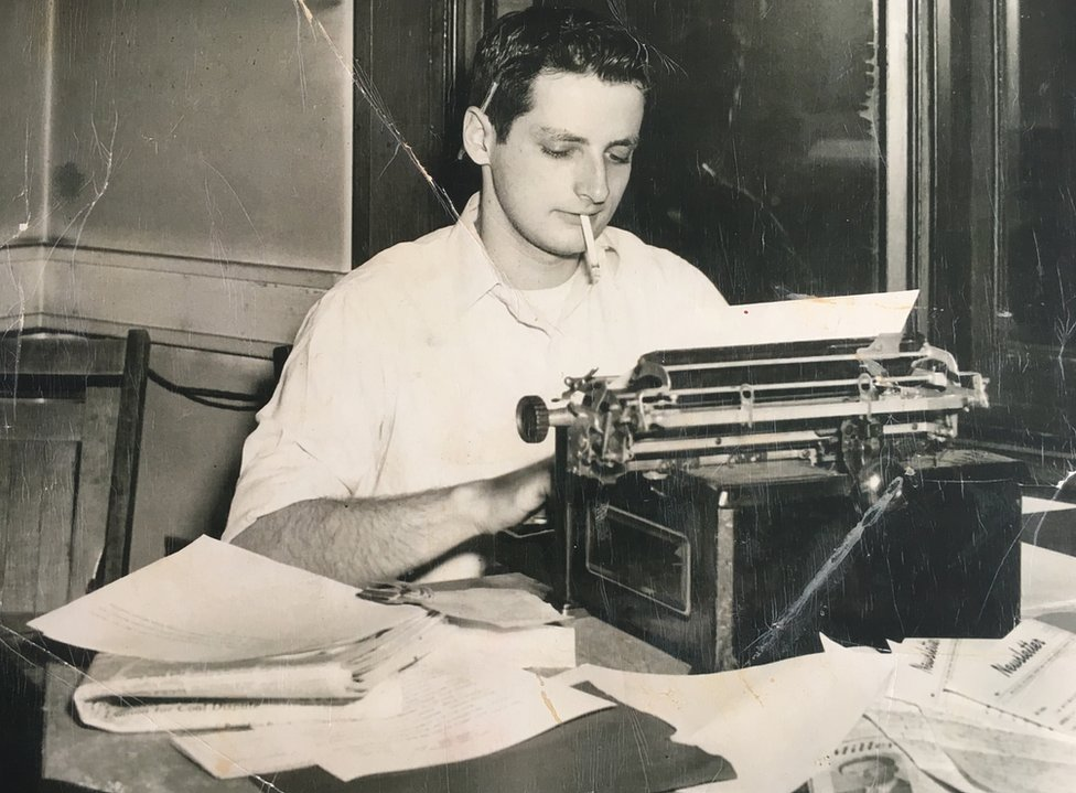 Leon Kamin works on a typewriter during his time as a student at Harvard University