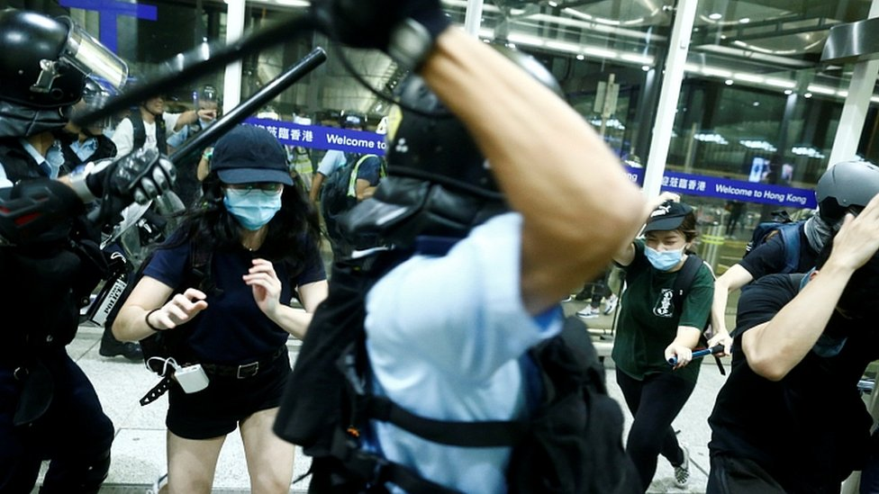 Police clash with anti-government protesters at the airport in Hong Kong, August 13, 2019