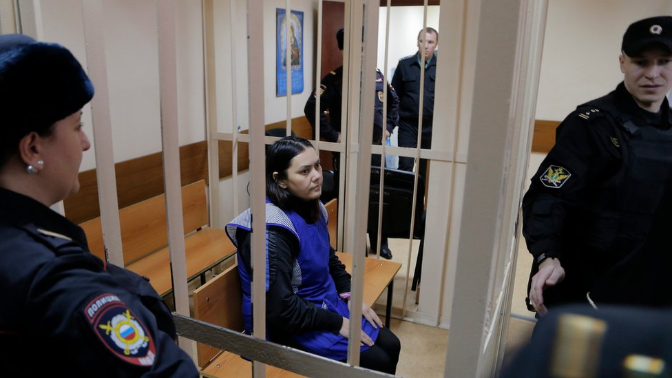 Gyulchehra Bobokulova (C) in a cage at the Presnensky district court in Moscow, Russia, 02 March 2016