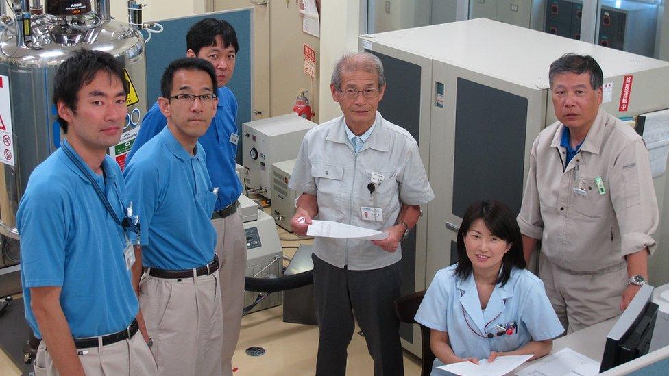Professor Akira Yoshino, centre