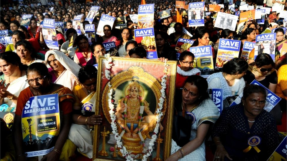 Members and supporters of Ayappa Dharma Samrakshana Samithi (a united forum of South Indian Ayyappa devotees) sit during a peaceful protest demanding special ordinance in relation with women's entry in Sabarimala temple, in New Delhi, India, 14 October 2018.