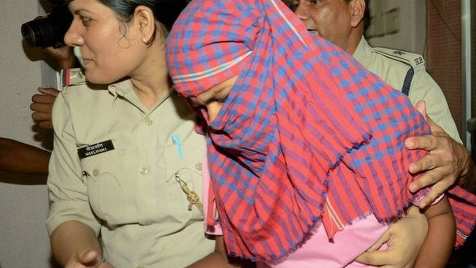 Ruby Rai with police after her arrest