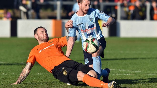 Action from Carrick Rangers against Ballymena United