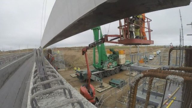 Bridge beam moved into position